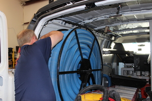 Water Damage Reno Technician Equipping Van