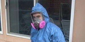 Technician In Full Gear To Remove A Mold Infestation