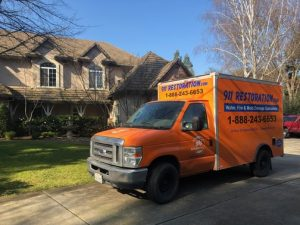 Sewage Restoration Truck At Residential Job Site