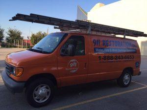 911 Restoration Van At A Commercial Property