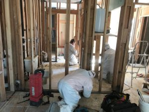 Technicians Reconstructing A Home After A Flood